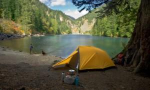Fisherman camping at a wilderness lake